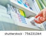 closeup pharmacist hand holding ... | Shutterstock . vector #756231364