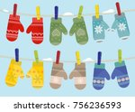Set Of Mittens Hanging On The...