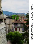 Small photo of Scenic Cityscape View of Bern's Buildings with Mountain in Background, View of the Old City of Bern from The Stone Bridge, over Aare river, Switzerland.