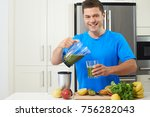 male athlete making juice or...   Shutterstock . vector #756282043