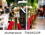 golden stanchions with a red... | Shutterstock . vector #756342139