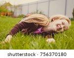 girl lying on green grass... | Shutterstock . vector #756370180