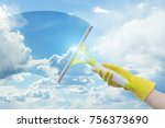 cleaner washes a window on a... | Shutterstock . vector #756373690