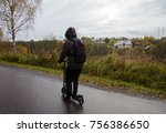 a young guy on a scooter  on...   Shutterstock . vector #756386650