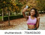 young sporty hispanic woman... | Shutterstock . vector #756403630
