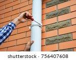 worker installing rain gutter... | Shutterstock . vector #756407608