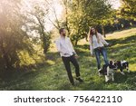 beautiful couple walking dogs...   Shutterstock . vector #756422110