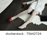 Crime scene. Legs of the lifeless woman - stock photo