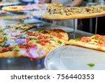 handsome pizzaiolo making pizza ... | Shutterstock . vector #756440353