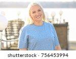 happy mature woman outdoors | Shutterstock . vector #756453994