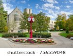 Small photo of BLOOMINGTON, IN/USA - OCTOBER 22, 2017: Landmark campus clock and logo on the campus of the University of Indiana.