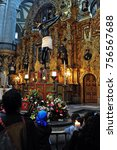 Small photo of MEXICO CITY - FEB 23 2010: Mexican people prays at the Catedral Metropolitana in Mexico City.Roman Catholicism continues to be the dominant religion in Mexico today, at nearly 89%.