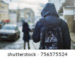 hipster man in hood walking...