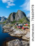 Lofoten Summer Landscape Lofoten is an archipelago in the county of Nordland, Norway. Is known for a distinctive scenery with dramatic mountains and peaks