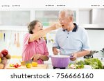 happy senior couple cooking in... | Shutterstock . vector #756666160