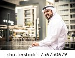 arabian businessman with laptop ... | Shutterstock . vector #756750679