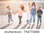 happy kids walking holding... | Shutterstock . vector #756773080