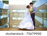 happy bride and groom is...   Shutterstock . vector #75679900