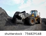 A Pile Of Coal Ore With A Fron...
