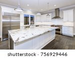 Stock photo large spacious kitchen design with white kitchen cabinets white kitchen island with lots of 756929446