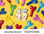 number 45 candle with party... | Shutterstock . vector #756945586