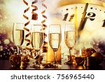 champagne glasses and clock at... | Shutterstock . vector #756965440