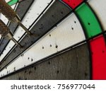 Small photo of Darts thrown into a dart board