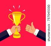 hand holding a winner's trophy...   Shutterstock .eps vector #757045330