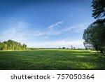 green fields and blue sky in... | Shutterstock . vector #757050364