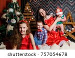 mother with kids in a christmas ... | Shutterstock . vector #757054678