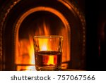 a class of whiskey by a cosy... | Shutterstock . vector #757067566
