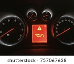 Small photo of Control panel of a car with oil alert