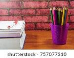 colored pencils on wooden desk... | Shutterstock . vector #757077310