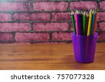 colored pencils on wooden desk... | Shutterstock . vector #757077328