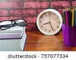 colored pencils on wooden desk... | Shutterstock . vector #757077334