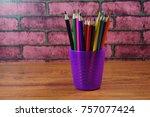 colored pencils on wooden desk... | Shutterstock . vector #757077424