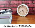 books  desk clock  glasses and... | Shutterstock . vector #757081684