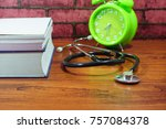 books  desk clock  stethoscope... | Shutterstock . vector #757084378