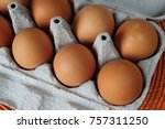 Fresh Brown Eggs With Yolk On...