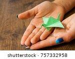 female hand holding an origami... | Shutterstock . vector #757332958