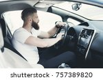 a young man with a beard sits... | Shutterstock . vector #757389820