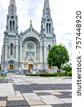 Small photo of Sainte-Anne-de-Beaupre, Canada - June 2, 2017: Exterior stone architecture of Basilica of Sainte Anne de Beaupre