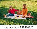 kids eating snacks outside.... | Shutterstock . vector #757510120
