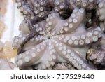 fresh octopus on display on ice ... | Shutterstock . vector #757529440