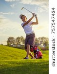 boy golf player hitting by iron ... | Shutterstock . vector #757547434