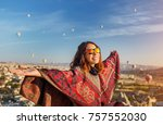 a tourist girl on a mountain... | Shutterstock . vector #757552030