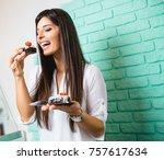 beautiful young woman enjoying ...   Shutterstock . vector #757617634