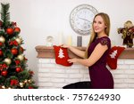 beautiful young woman holding...   Shutterstock . vector #757624930