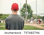 baseball coach watching the game | Shutterstock . vector #757682746