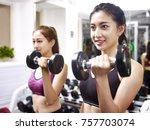 two young asian women working... | Shutterstock . vector #757703074